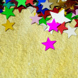 Stock Photo: Colorful stars on gold background, close up