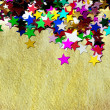 Colorful stars on gold background - Stok fotoğraf