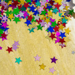 Stock Photo: Colorful stars on gold background, portrait