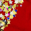 Stock Photo: Colorful stars on red velvet background