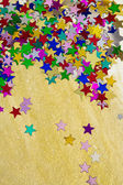 Colorful stars on gold background, portrait — Stock Photo