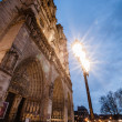Notre Dame de Paris, facade at dusk - Stock Photo