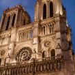 Notre Dame de Paris, facade at dusk — Stock Photo