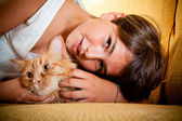 Girl and her cat — Stock Photo