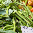 Broad beans for sale at market - Stock Photo