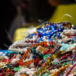 Stock Photo: Heap of cheap jewelry