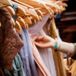 Rack of dresses at market — Stock Photo