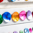 Stock Photo: Row of colorful buttons
