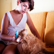 Girl grooming her cat — Stock Photo #35801685