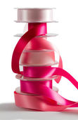 Stack of pink satin ribbon — Stock Photo