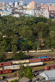 View of Yangon, Myanmar, with train station, urban jungle — Stock Photo