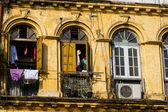 Facade of an old, run-down colonial building in Yangon, Myanmar. — Stock Photo