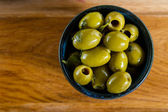Olives in rustic bowl — Stock Photo