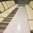 Row of empty seats in the waiting lounge of an airport — Stock Photo