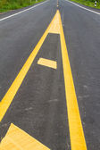 Yellow line on the road texture background — Stock Photo