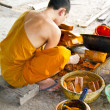 Buddhist making a candle — Stock Photo