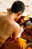 Buddhist making a candle — Foto Stock