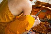 Buddhist making a candle — Zdjęcie stockowe