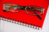 Notebook a brýle — Stock fotografie