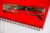 Notebook and glasses — Stockfoto