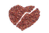 Heart of red beans on a white background — Stock Photo
