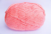 Pink ball of woollen thread isolated on white — Stock Photo