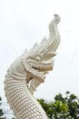 Dragons near the gold Buddha statue — Stock Photo