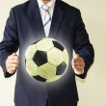 Businessman holding a soccer ball — Stock Photo #49503555