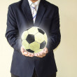 Businessman holding a soccer ball — Stock Photo #49503461