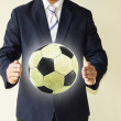 Businessman holding a soccer ball — Stock Photo #49503555