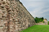 Stone wall of old castle — Stock Photo