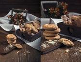 Cookies and dry orange roses — Stock Photo