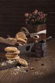 Cookies and boxes with coffee beans — Stock Photo