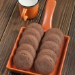 Stock Photo: Brown biscuits in orange ceramic pan