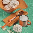 Top view of meringues and orange cup — Stock Photo