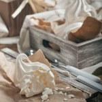 Broken meringue on brown paper — Stock Photo
