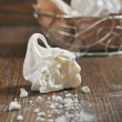 Broken meringue on wooden background — Stock Photo
