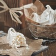 Meringues in iron bowl — Stock Photo