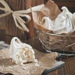 Meringues in iron bowl — Stock Photo