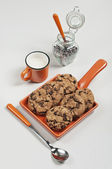 Brown biscuits and chocolate drops — Stock Photo