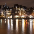 Seine in the night and Hotel de Ville - Stock Photo