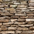 Of rough stone wall of big and small rocks — Stock Photo