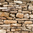 Of rough stone wall of big and small rocks — Stock Photo #26204575