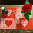 Foto de Stock  : Nice red rose decorated table with two glass and champagne