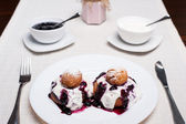 Donuts with jam and cream — Stock Photo