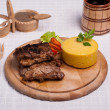 Meat with polenta on the wood with re wine — Stock Photo
