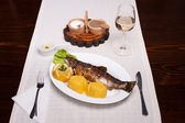 Grilled trout with polenta, lemon, garlic sauce and wine — Stock Photo