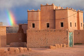 Rainbow over a traditional house in Morocco in desert — Stock Photo
