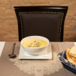 Stock Photo: Tripe soup in white bowl served with focaccia