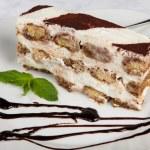 Slice of self-made italian tiramisu dessert served on a plate — Stock Photo #42612079
